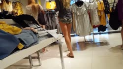 Candid voyeur girl shopping in tiny camo shorts