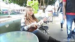 Sexy Girl flashing and playing the ukulele